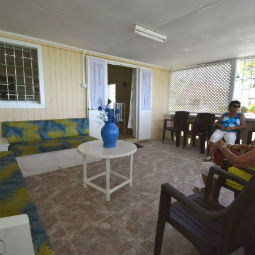 Inside Barbados Beach Cottage Porch Area